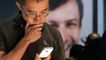 A customer examines the new iPhone.