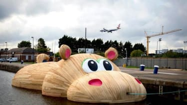 Dutch artist puts giant inflatable hippo in the River Thames