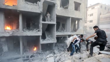 Syrians search for survivors after a bombing