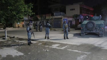 Police outside the Kabul guest house where an American was killed Wednesday.