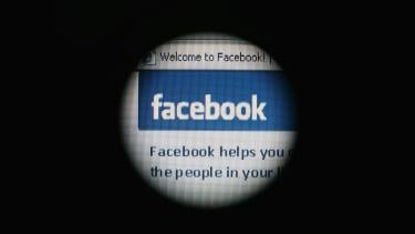 The Facebook site through a laptop screen