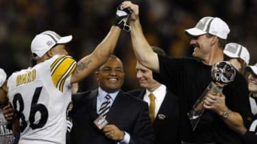 Pittsburgh Steelers coach Bill Cower (right and Hines Ward high-five after beating the Seattle Seahawks in the 2006 Super Bowl.