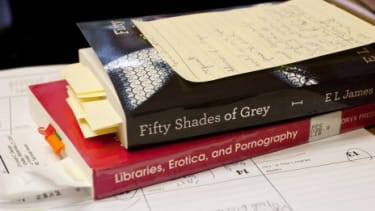 """E. L. James' best-selling novel """"Fifty Shades of Grey"""" sits on the desk of Gwinnett County Public Library's Deborah George, who wants her 15-branch library system in Georgia to yank the book"""