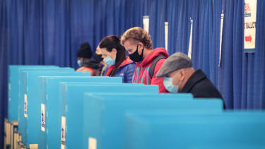 People voting with masks on.