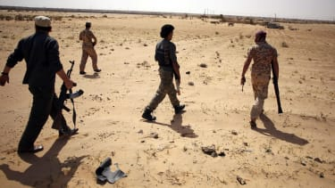 Libya Dawn fighters search for Islamic State militants in March.