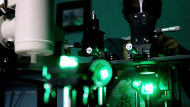 Research scholar experiments with lasers.