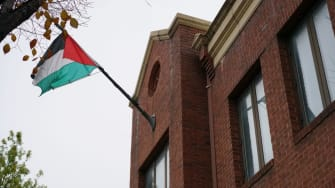 The flag of the Palestine Liberation Organisation is seen above its offices in Washington, DC on November 18, 2017.