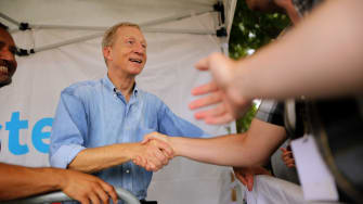 Tom Steyer shakes hands at the Iowa state fair.