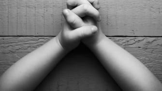 A child in prayer.