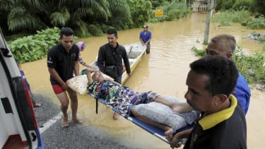 Malaysia evacuates thousands as nation struggles with worst flooding in decades