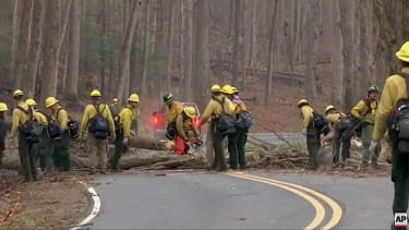 Firefighters clear a road in Great Smokey Mountains National Park