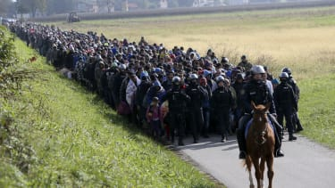 Migrants are guided to the Slovenian border.