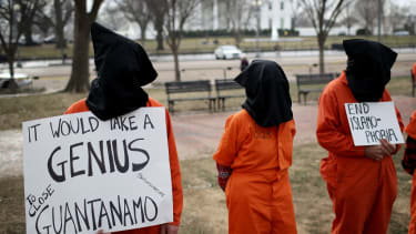 Trump signs order to keep Guantanamo prison open