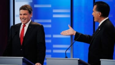 Mitt Romney extends his hand and bets Texas Gov. Rick Perry $10,000 during Saturday's debate, a potential reminder to struggling Americans that Romney is very, very wealthy.