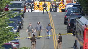 Officers at the scene of the shooting.