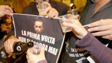 Italians celebrate the sentencing of former Prime Minister Silvio Berlusconi.