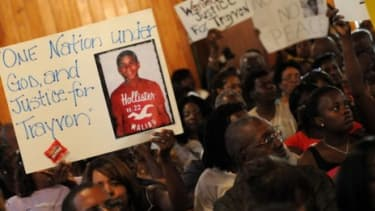 Civil rights leaders and residents of Sanford, Fla., attend a town hall meeting to discuss the death of 17-year-old Trayvon Martin: The teen was shot and killed by a self-appointed neighborho