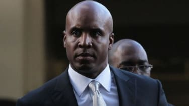 Former Major League Baseball star Barry Bonds arrives for the first day of his perjury trial Monday.