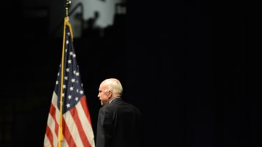 Sen. John McCain near an American Flag