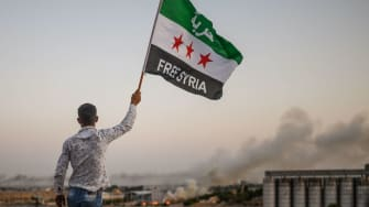A man waves an opposition flag in Syria.
