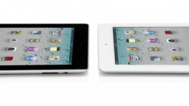 The new iPad (right) is 0.2 pounds lighter and is thinner than an iPhone.