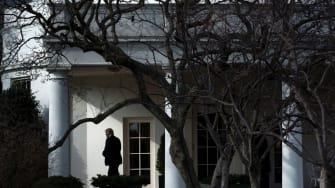 President Trump walks outside the White House