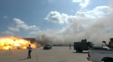 A video grab shows the moment an ordnance hit the airport in the southern Yemeni port city of Aden on December 30.