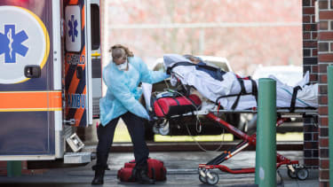 First responders load a patient into an ambulance  in Chelsea, Massachusetts