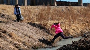 A migrant girl crosses into El Paso.