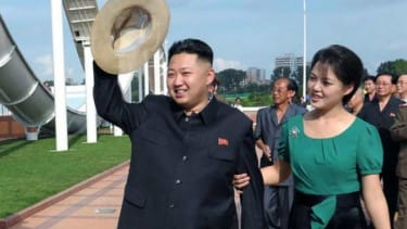 """Kim Jong Un, accompanied by his wife Ri So Ju on July 25, shows off that """"boyish charm"""" that made him The Onion's """"Sexiest Man Alive"""" 2012."""