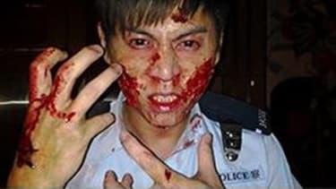 Hong Kong official shares fake photo of beaten-up cop
