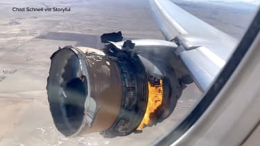 Boeing 777 with engine on fire