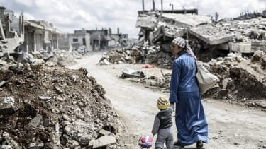 A Syrian child and his mother in Kobane, Syria.