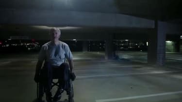 Texas Republican candidate Greg Abbott climbs up through parking garage in his wheelchair for new TV ad