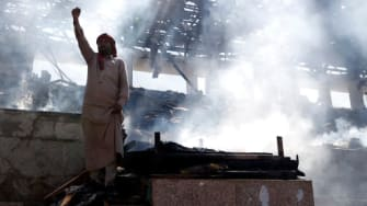 A man in a bombed out house in Sanaa.
