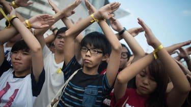 Hong Kong protesters block streets on China's National Day