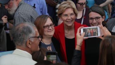 Elizabeth Warren poses with voters.