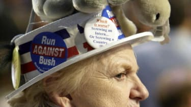 Woman wears a stuffed donkey hat to represent the Democratic Party.