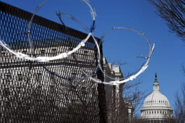 Barbed wire surrounding Capitol.