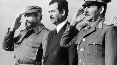 Iraqi vice-president Saddam Hussein (C), stands with Cuban President Fidel Castro (L) and Defense minister General Raul Castro (R)