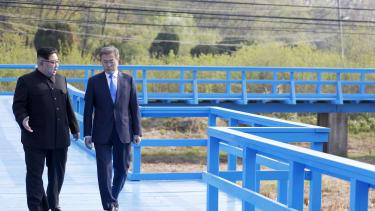 North Korean leader Kim Jong Un and South Korean President Moon Jae-in discuss