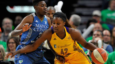 Natasha Howard of the Minnesota Lynx guards against Jantel Lavender of the Los Angeles Sparks in the 2016 WNBA Finals.