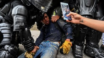 A protester being arrested.