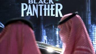 "Saudi Arabians wait to watch ""Black Panther."""