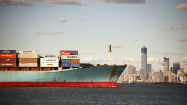 A container ship leaves New York.