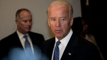 "Vice President Joe Biden's office denies that he likened Tea Partiers to ""terrorists"" during a closed-door meeting."