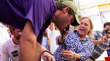 Senator Mary Landrieu aids keg stand at football game