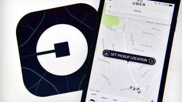 Uber logo and smartphone.
