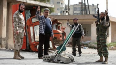Syrian fighters test out a new rocket in Aleppo on April 1.