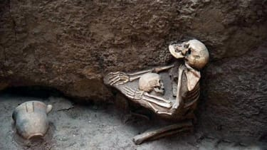 The 4,000-year-old remains of a mother and child embracing.